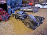 Batmobile in junkyard diorama